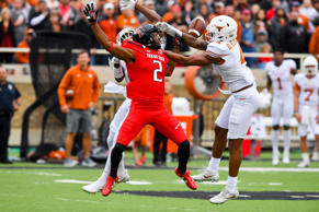 DeShon Elliott #4 of the Texas Longhorns breaks up a pass intended for Reginald Davis III #2 of the Texas Tech Red Raiders during the game on November 5, 2016 at AT&T Jones Stadium in Lubbock, Texas. Texas defeated Texas Tech 45-37.