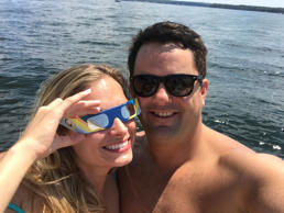 This photo provided by Micah Caskey shows Caskey and Erin Harris posing for a selfie on Lake Murray in South Carolina on Monday, Aug. 21, 2017. Caskey, a South Carolina state representative, asked for Harris' hand in marriage during the total eclipse.