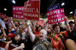 Supporters cheer as President Donald Trump speaks at a rally at the Phoenix Conv...