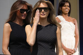 Melania looked chic in a Jason Wu pinstripe dress - one of Michelle Obama's favourite fashion designers (Image: Rex/Getty)