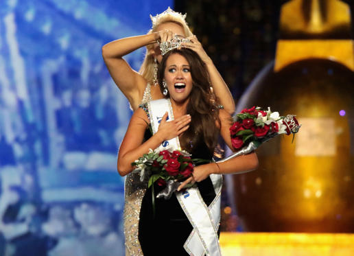 Slide 1 of 52: ATLANTIC CITY, NJ - SEPTEMBER 10: Miss North Dakota 2017 Cara Mund is crowned as Miss America 2018 by Miss America 2017 Savvy Shields during the 2018 Miss America Competition Show at Boardwalk Hall Arena on September 10, 2017 in Atlantic City, New Jersey. (Photo by Donald Kravitz/Getty Images for Dick Clark Productions)