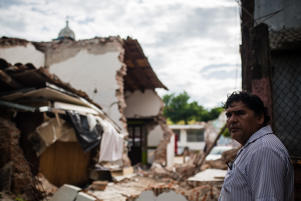 JUCHITAN, MEXICO - SEPTEMBER 10: A man looks between the debriss after the earthquake, in Juchitan, Mexico on 10, September 2017. An earthquake with a magnitude of 8.2 and epicenter in the state of Chiapas, hit the south of Mexico.  (Photo by Manuel Velasquez/Anadolu Agency/Getty Images)