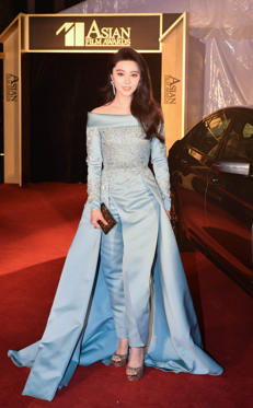 Slide 2 of 13: Fan Bingbing arrives at the red carpet of the 11th Asian Film Awards at Hong Kong Cultural Centre on March 21, 2017 in Hong Kong, China.
