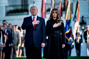 US President Donald Trump and First Lady Melania Trump observe a moment of silence on September 11, 2017, at the White House in Washington, DC, during the 16th anniversary of 9/11. / AFP PHOTO / Brendan Smialowski        (Photo credit should read BRENDAN SMIALOWSKI/AFP/Getty Images)