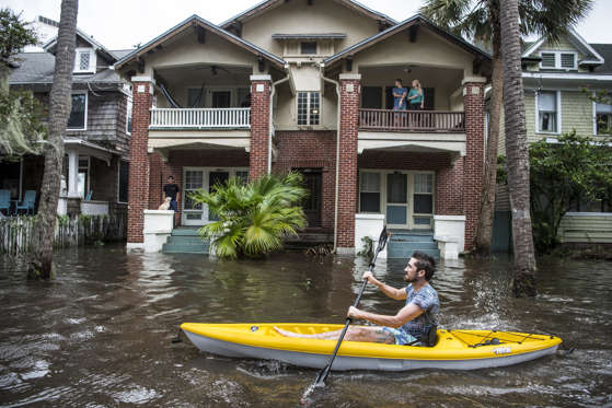 Slide 10 of 127: Justin Hand navigates storm surge flood waters from Hurricane Irma along the St. Johns River on Sept. 11, 2017 in Jacksonville, Florida. Flooding in downtown Jacksonville along the river topped a record set during Hurricane Dora in 1965.