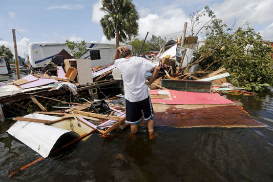 Slide 13 of 127: Larry Dimas walks around his destroyed trailer, which he rents out to others, in the aftermath of Hurricane Irma in Immokalee, Fla., Monday, Sept. 11, 2017. His tenants evacuated, and nobody was inside when it was destroyed.