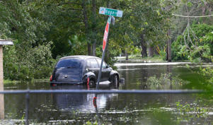 A car remains in a flooded street after passage of hurricane Irma in Orlando, Florida, USA, 11 September 2017. Irma left 6.5 million houses and offices without energy according to the main providers