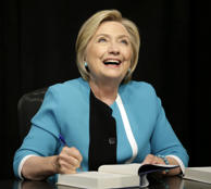 "Hillary Rodham Clinton signs copies of her book ""What Happened"" at a book store in New York, Tuesday, Sept. 12, 2017."