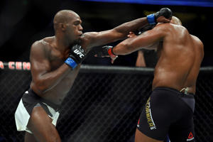 Jon Jones punches Daniel Cormier in their UFC light heavyweight championship bout during the UFC 214 event inside the Honda Center on July 29, 2017 in Anaheim, California.