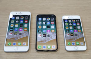 iPhone 8 Plus, iPhone X and iPhone 8 models are displayed during an Apple launch event in Cupertino, California, U.S. September 12, 2017.