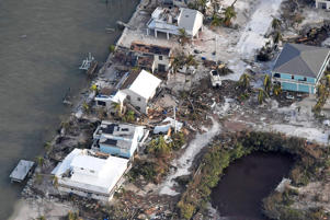 FLORIDA KEYS, FL - SEPTEMBER 11: Damaged houses are seen in the aftermath of Hurricane Irma on September 11, 2017 over the Florida Keys, Florida (Photo by Matt McClain -Pool/Getty Images)