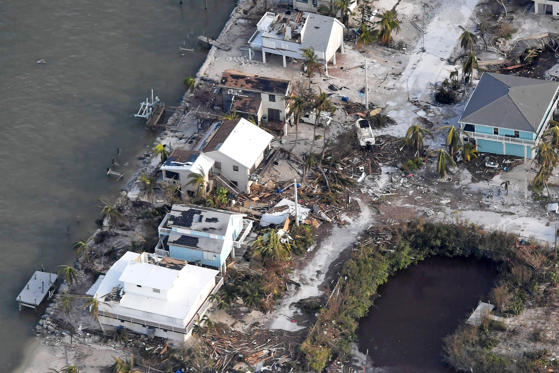 Slide 1 of 10: FLORIDA KEYS, FL - SEPTEMBER 11: Damaged houses are seen in the aftermath of Hurricane Irma on September 11, 2017 over the Florida Keys, Florida (Photo by Matt McClain -Pool/Getty Images)