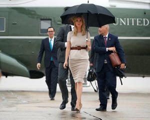 Ivanka Trump, the daughter and assistant to President Donald Trump, center, followed by Treasury Secretary Steve Mnuchin, left, walk across the tarmac to board Air Force One at Andrews Air Force Base, Md., Wednesday, Sept. 6, 2017.