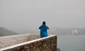 A man takes photos of the rain and strong winds effects from a lookout point along the scenic road before the arrival of hurricane Max in Puerto Marquez, Guerrero state, Mexico on September 14, 2017. Hurricane Max formed off the southwestern coast of Mexico on Thursday, triggering warnings of life-threatening storm conditions for a long stretch of coastal communities including the resort city of Acapulco, forecasters said.