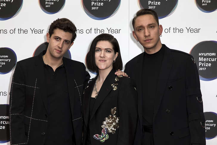 Musicians from left, Jamie Smith, Romy Madley Croft, and Oliver Sim of the group 'The XX' pose for photographers on arrival at the Mercury Prize 2017 awards, in London, Thursday, Sept.14, 2017