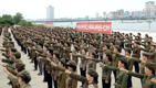 This picture taken on August 14, 2017 and released by North Korea's official Korean Central News Agency (KCNA) on August 15 shows members of the Socialist Women's Union in the DPRK at a rally in support of North Korea's stance against the US, at the plaza of the Tower of the Juche Idea in Pyongyang.