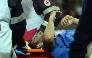 Napoli's Argentinian forward Gonzalo Gerardo Higuain is evacuated during the Italian Seria A football match Inter Milan vs Napoli, on April 26, 2014 in San Siro stadium in Milan. AFP PHOTO / OLIVIER MORIN
