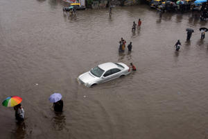 Local residents and civic authorities in Mumbai struggled to cope as most roads were submerged and commuters waded through waist-deep floodwater in August.