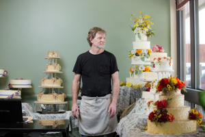Jack Phillips stands for a portrait near a display of wedding cakes in his Masterpiece Cakeshop in Lakewood, CO on Thursday, September 1, 2016. Phillips is one of the bakers who does not want to bake wedding cakes for same-sex couples, saying it violates his religious beliefs.