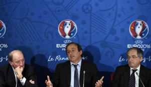 EURO 2016 President Jacques Lambert, UEFA President Michel Platini, and French Football Federation (FFF) President Noel le Graet. AFP PHOTO / FRANCK FIFE