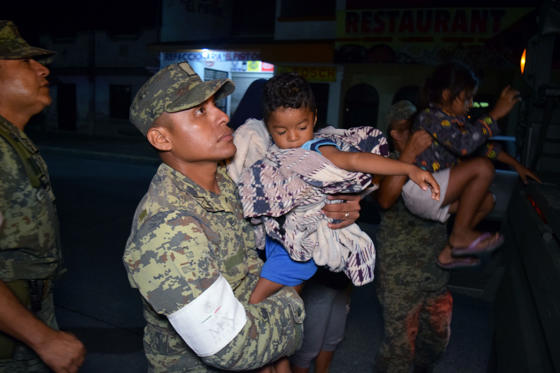 Slide 1 of 12: Soldiers help children to get on a truck as residents are being evacuated from their coastal town after an earthquake struck off the southern coast, in Puerto Madero, Mexico September 8, 2017.  REUTERS/Jose Torres NO RESALES. NO ARCHIVES - RC1F1D480600