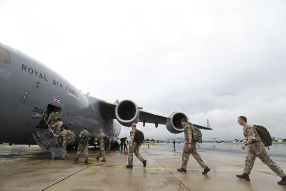 Slide 3 of 51: Soldiers board a Royal Air Force C-17 Globemaster III aircraft at Brize Norton, Oxfordshire, before they are flown to help out in the areas affected by Hurricane Irma as winds of up to 175mph left death and destruction in the Atlantic. (Photo by Andrew Matthews/PA Images via Getty Images)