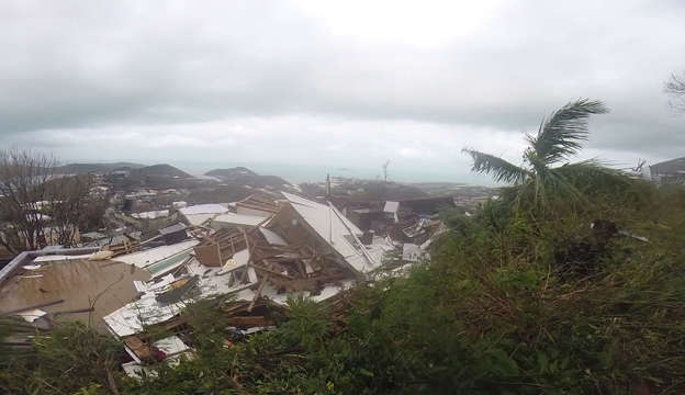 Slide 4 of 55: This image made from video shows several damaged houses by Hurricane Irma in St. Thomas, U.S. Virgin Islands, Thursday, Sept. 7, 2017. Hurricane Irma weakened slightly Thursday with sustained winds of 175 mph, according to the National Hurricane Center. The storm boasted 185 mph winds for a more than 24-hour period, making it the strongest storm ever recorded in the Atlantic Ocean. The storm was expected to arrive in Cuba by Friday. It could hit the Florida mainland by late Saturday, according to hurricane center models. (AP Photo/Ian Brown)