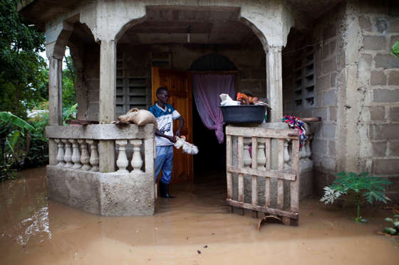Slide 1 of 55: A man salvages items from his home flooded by heavy rains brought on by Hurricane Irma, in Fort-Liberte, Haiti, Friday Sept. 8, 2017. Irma rolled past the Dominican Republic and Haiti and battered the Turks and Caicos Islands early Friday with waves as high as 20 feet (6 meters). ( AP Photo/Dieu Nalio Chery)