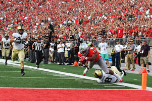 J.K. Dobbins of the Ohio State Buckeyes dives in to the end zone after being tripped up at the goal line by Rhyan England of the Army Golden Knights to complete a 52-yard touchdown run on Sep. 16 in Columbus, Ohio. Ohio State defeated Army 38-7.