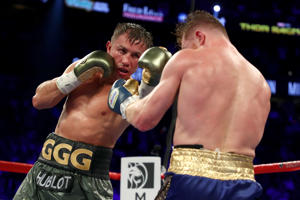 Gennady Golovkin throws a punch at Canelo Alvarez during their WBC, WBA and IBF middleweight championship bout at T-Mobile Arena on September 16, 2017 in Las Vegas, Nevada.