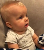 Baby hears dad play guitar for first time