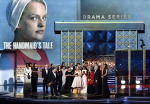 LOS ANGELES, CA - SEPTEMBER 17:  Cast and crew of 'The Handmaid's Tale' accept the Outstanding Drama Series award onstage during the 69th Annual Primetime Emmy Awards at Microsoft Theater on September 17, 2017 in Los Angeles, California.  (Photo by Lester Cohen/WireImage)