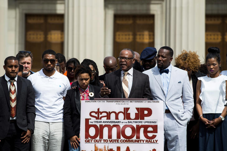 FILE: Community Leaders gather at City Hall for a rally on the one-year anniversary of the Baltimore Riots after the death of Freddie Gray in Baltimore, USA on April 25, 2016.