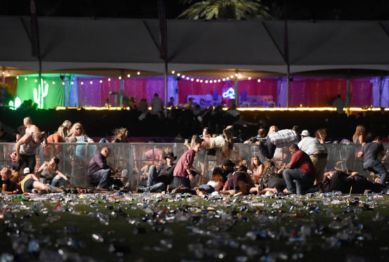 Slide 1 of 30: People dive for cover at Route 91 Harvest country music festival after apparent gun fire was heard on October 1, 2017 in Las Vegas, Nevada.