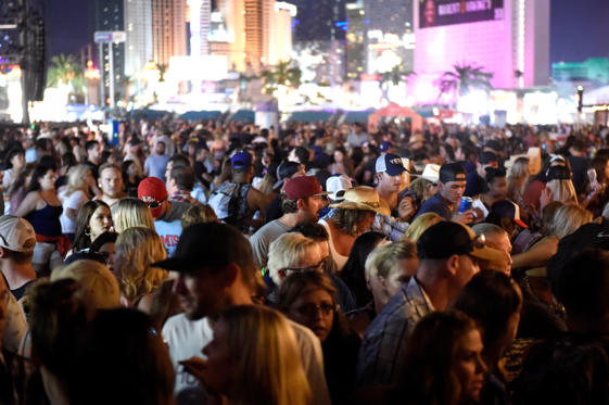 Slide 16 of 16: A crowd of  people at the Route 91 Harvest country music festival after apparent gun fire was heard on October 1, 2017 in Las Vegas, Nevada.