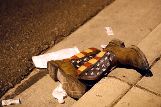 Slide 55 of 68: A pair of cowboy boots is shown in the street outside the concert venue after a mass shooting at a music festival on the Las Vegas Strip in Las Vegas, Nevada, U.S. October 1, 2017.
