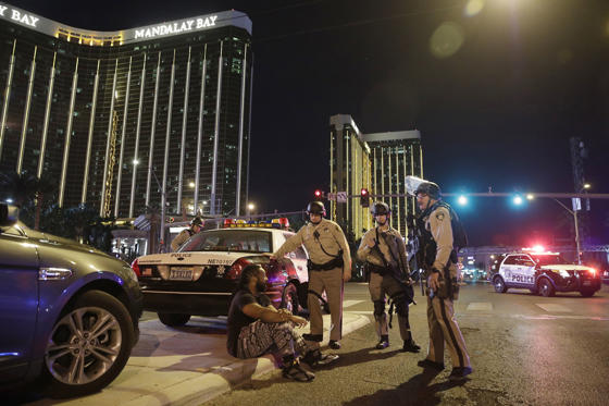 Slide 3 of 16: Police officers stand at the scene of a shooting near the Mandalay Bay resort and casino on the Las Vegas Strip, Sunday, Oct. 1, 2017, in Las Vegas. Multiple victims were being transported to hospitals after a shooting late Sunday at a music festival on the Las Vegas Strip.