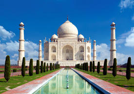 Taj mahal on a bright day in Agra, India - A monument of love in clear blue sky