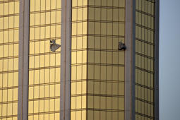 Drapes billow out of broken windows at the Mandalay Bay resort and casino Monday, Oct. 2, 2017, on the Las Vegas Strip following a deadly shooting at a music festival in Las Vegas. A gunman was found dead inside a hotel room.