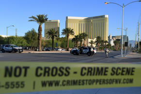 Crime scene tape surrounds the Mandalay Hotel (background) after a gunman killed at least 50 people and wounded more than 200 others when he opened fire on a country music concert in Las Vegas, Nevada on October 2, 2017.  Police said the gunman, a 64-year-old local resident named as Stephen Paddock, had been killed after a SWAT team responded to reports of multiple gunfire from the 32nd floor of the Mandalay Bay, a hotel-casino next to the concert venue.