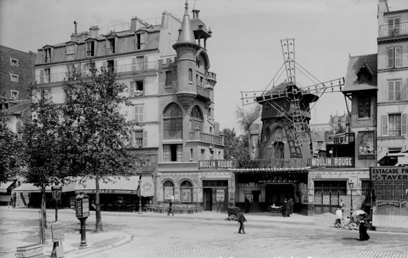 Slide 1 of 8: FRANCE - CIRCA 1895:  Paris (XVIIIth district). The Moulin Rouge (Red Windmill), by E. Lagrange.  (Photo by LL/Roger Viollet/Getty Images)
