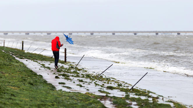 Slide 1 of 21: A walker fights with his umbrella due to heavy wind as he walks on the seaside on the North Sea Coast in Rastede in Lower Saxony on October 5, 2017 as torrential rain and gusts of winds are expected to hit north and east Germany, rising to hurricane force in cities such as Bremen, Hamburg and Berlin. / AFP PHOTO / dpa / Mohssen Assanimoghaddam / Germany OUT        (Photo credit should read MOHSSEN ASSANIMOGHADDAM/AFP/Getty Images)