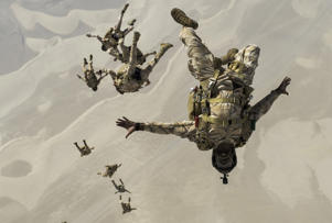 In this Aug. 21, 2017, Qatari special operations personnel conduct a military free-fall Friendship Jump over Qatar. The U.S. military has halted some exercises with its Gulf Arab allies over the ongoing diplomatic crisis targeting Qatar,  trying to use its influence to end the monthslong dispute, authorities told The Associated Press on Friday, Oct. 6, 2017.
