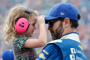 Jimmie Johnson, driver of the #48 Lowe's Chevrolet, shares a moment with his daughter, Lydia, on the grid prior to the Monster Energy NASCAR Cup Series Tales of the Turtles 400 on Sept. 17 in Joliet, Illinois.
