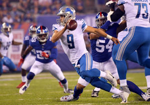 Detroit Lions quarterback Matthew Stafford (9) runs with the ball against the New York Giants during a NFL football game at MetLife Stadium.
