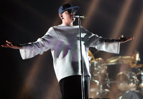 A photo of deceased Chester Bennington of Linkin Park performing at The O2 Arena in England.
