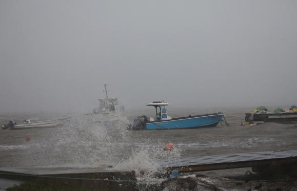Slide 4 of 20: Boats remain anchored in a wharf as Hurricane Maria approaches in Guadeloupe island, France, September 18, 2017.
