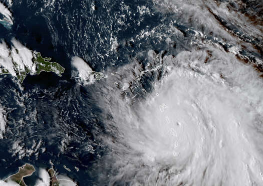 Slide 2 of 20: This Monday, Sept. 18, 2017, GOES East satellite image provided by NASA taken at 20:30 UTC, shows the eye of Hurricane Maria as it nears Dominica. The National Hurricane Center in Miami said Monday evening that Air Force Reserve hurricane hunter planes found that Maria had strengthened into a storm with 160 mph (260 kph) winds.