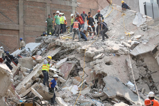 Slide 4 of 42: First responders work on removing the rubble of a collapsed building looking for survivors trapped underneath, after a 7.1 earthquake in Mexico City, Tuesday, Sept. 19, 2017.  The earthquake stunned central Mexico, killing more than 100 people as buildings collapsed in plumes of dust.  (AP Photo/Gustavo Martinez Contreras)