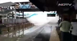 Viral video: Train splashes water on waiting commuters in Mumbai